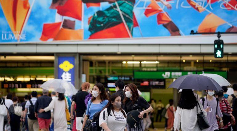 Tokyo hits Covid-19 high as Australia limits arrivals